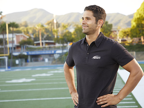 a personal trainer standing on football field