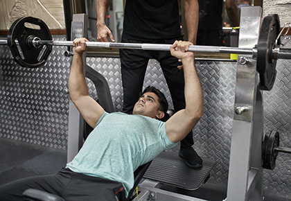man doing maximal strength bench press set using the OPT model