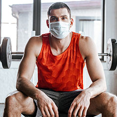 man wearing mask at gym