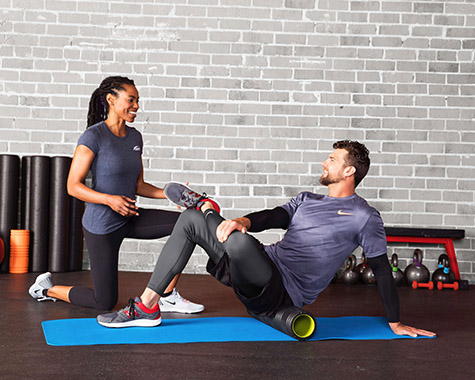 man and woman doing foam rolling exercises for stabilization training